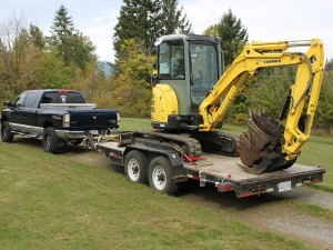 Dirty Digger Contracting Services - Truck and Vio 35 on Hauling Trailer